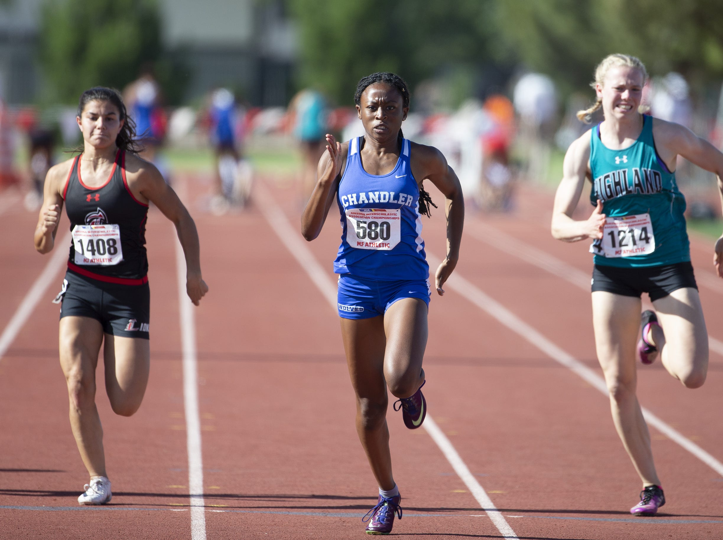Liberty's Ella Escobar, Chandler's Jocelyn Johnson, and Highland's Alisha Ellsworth compete in the Girls 100 meter dash Div. I during the state track and field meet at Mesa Community college on May 1, 2019.