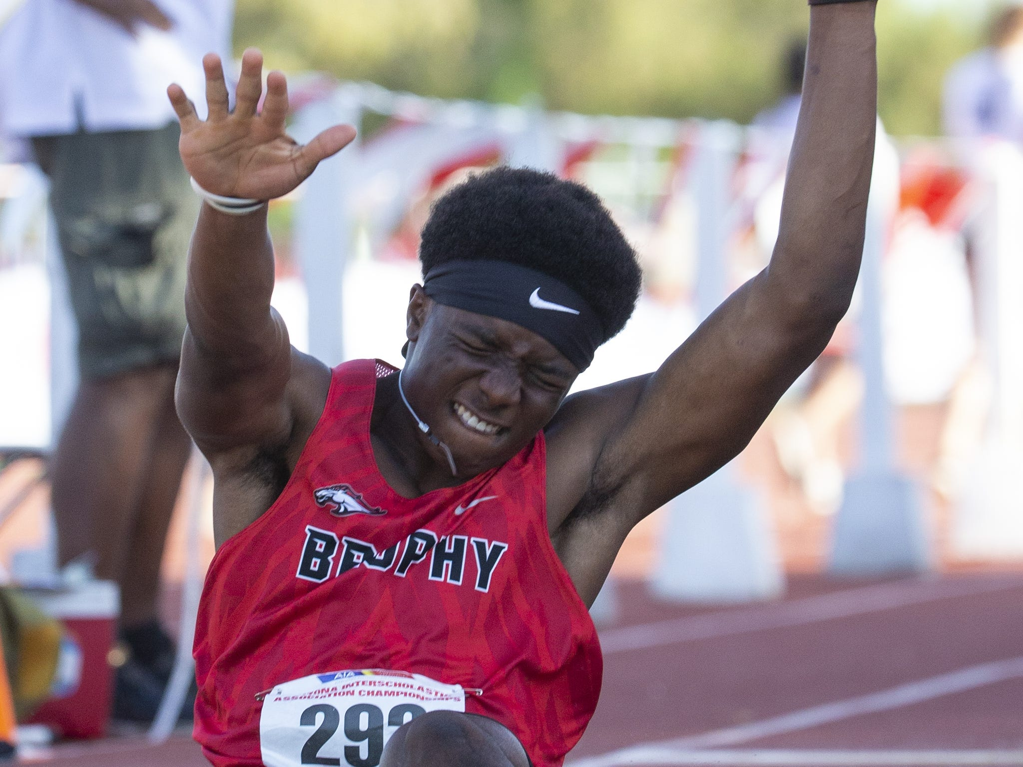 Trophy's Emeka Ogbonna competes in Boys long jump Div. I during the state track and field meet at Mesa Community college on May 1, 2019.