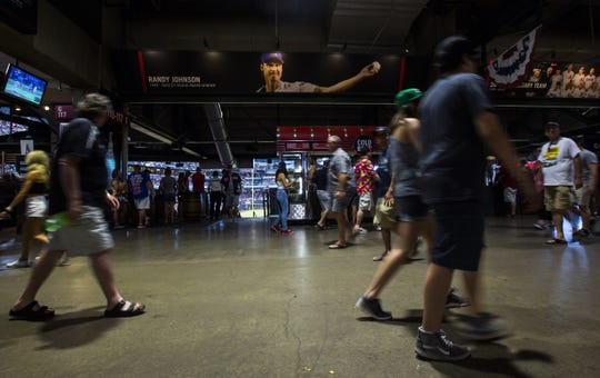 Fans make their way through the concourse level of Chase Field during the seventh inning of a Diamondbacks game against the Red Sox on April 7.