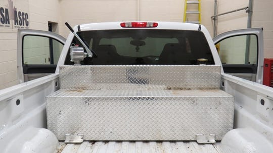 "Arizona law enforcement accuse a Cuban crime ring of selling fuel on the black market from trucks with ""slip tanks"" that look like tool boxes and can be found online for around $200. This truck with an auxiliary fuel tank was seized by the Canada Border Services Agency in 2014 when a smuggled person was found inside."