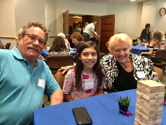 Brooklyn Perez, 11, with her pen pals Sherlyn Scott and Bob Griffin at Vi at Grayhawk, a senior living community in Scottsdale.