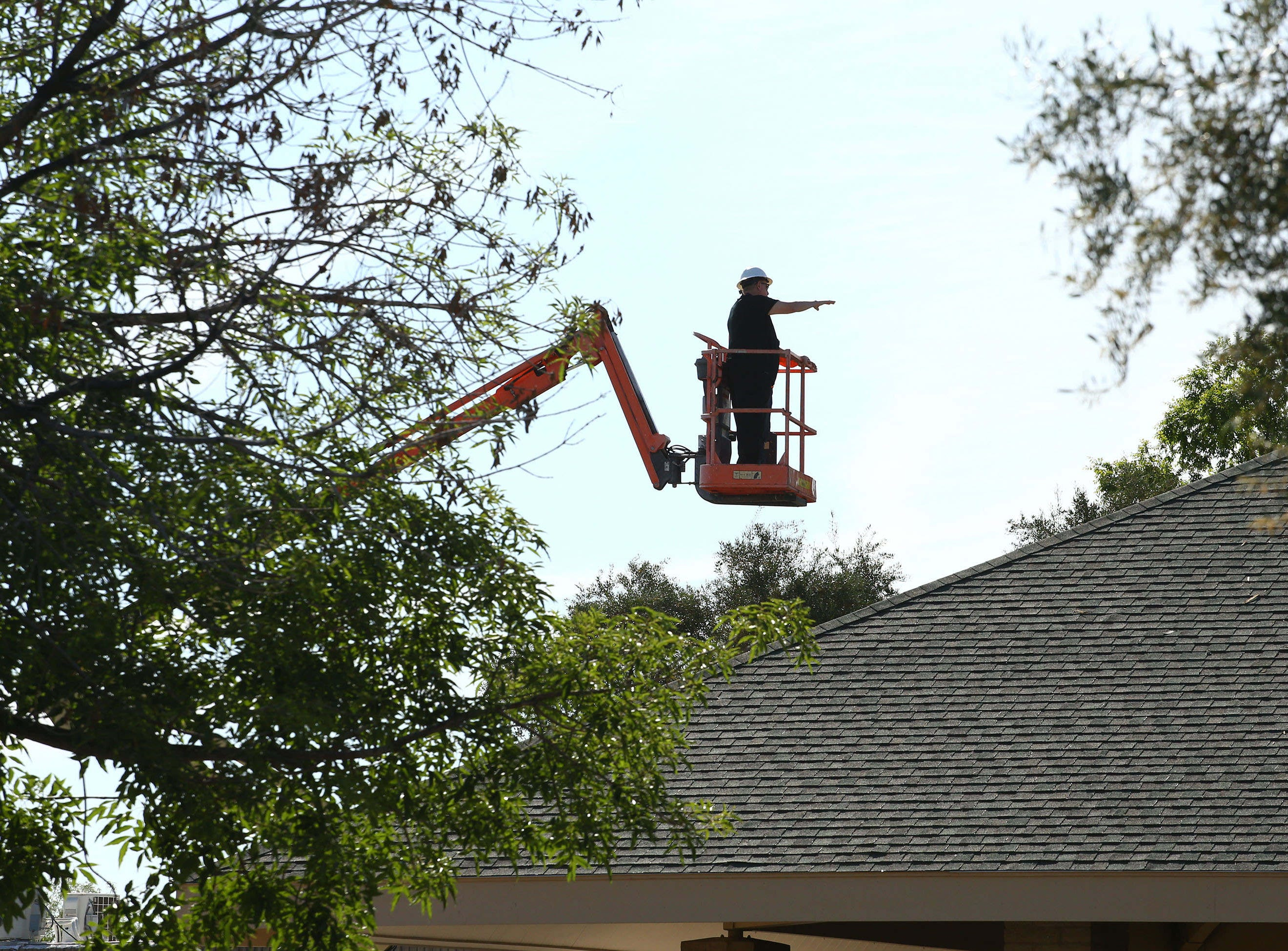 Crews survey the damage at St. Joseph Catholic Church on May. 2, 2019 at 40th Street and Desert Cove Avenue in Phoenix.