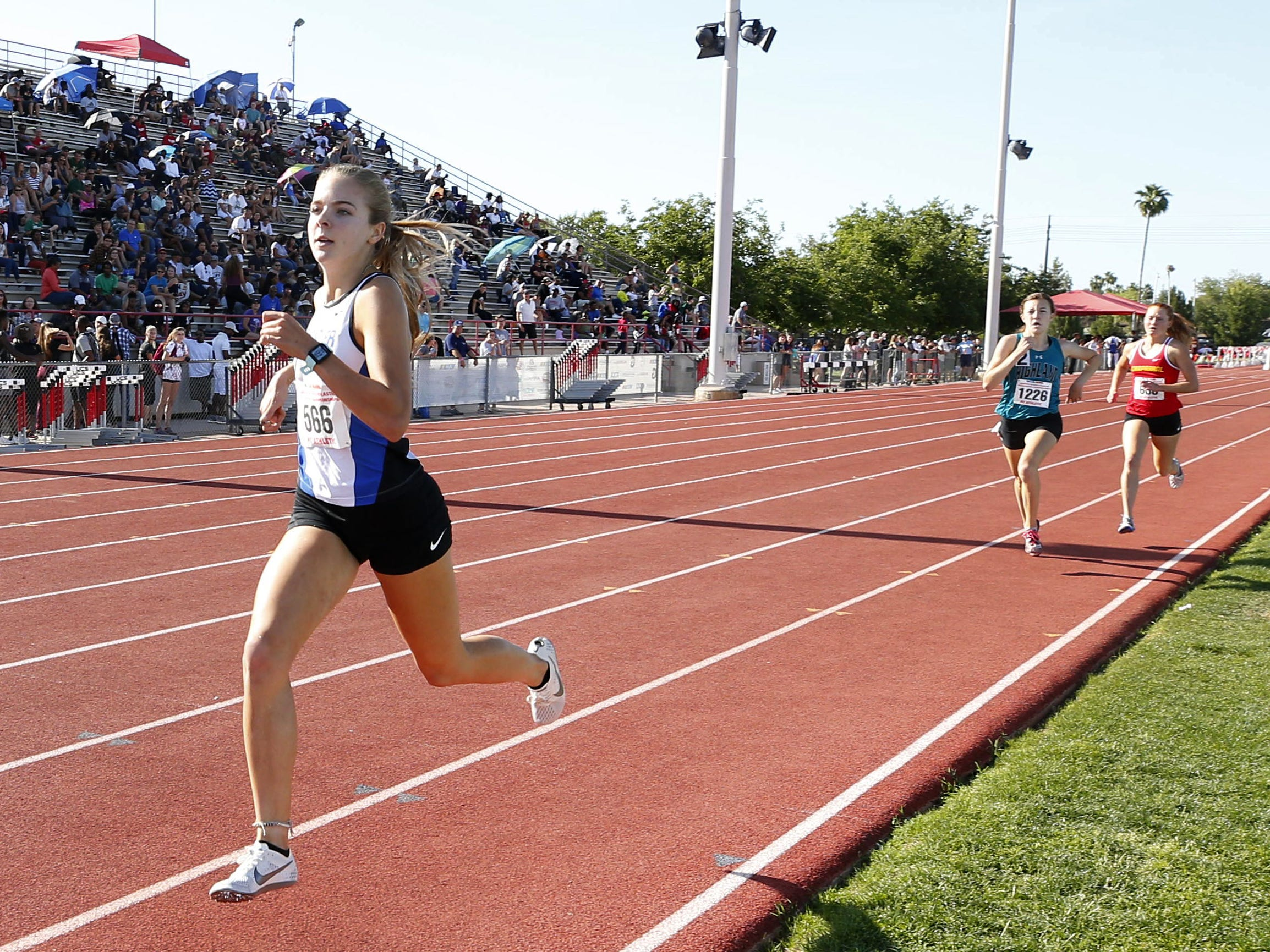 Chandler's Morgan Foster takes the lead over Highland's Caroline McLeskey, and Chaparral's Abi Archer in the Girls 1600 meter run Div. I during the state track and field meet at Mesa Community college on May 1, 2019.