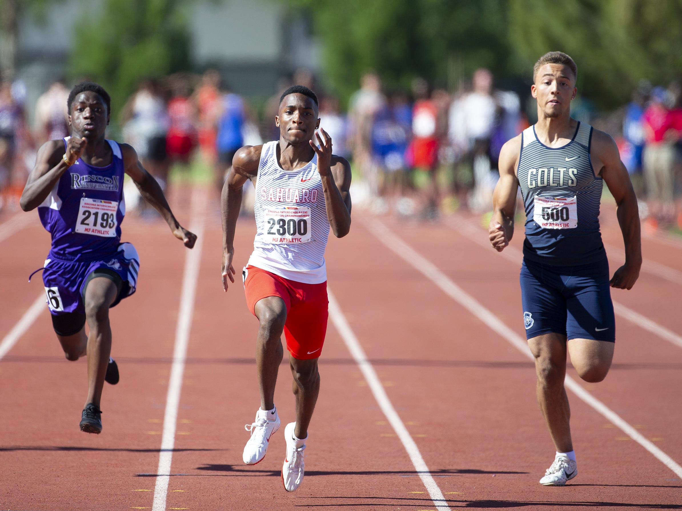 Rincon University's Abdulahi Mohamed, Scottsdale Saquaro Trayvion White, and Casteel's Brandon Thomas compete in the Boys 100 Meter das Div. II during the state track and field meet at Mesa Community college on May 1, 2019.
