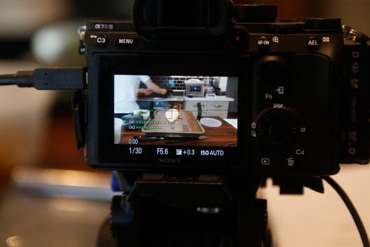 Cameras capture the action for twitch as Chris Blackwood makes his Chicken Piccata in his kitchen of his home in Phoenix, Ariz. on April 29, 2019.