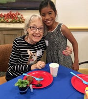 Helen Hutchison with her pen pal Tess Shaw, 11, at Vi at Grayhawk, a senior living community in Scottsdale. The two have been writing back and forth all school year.