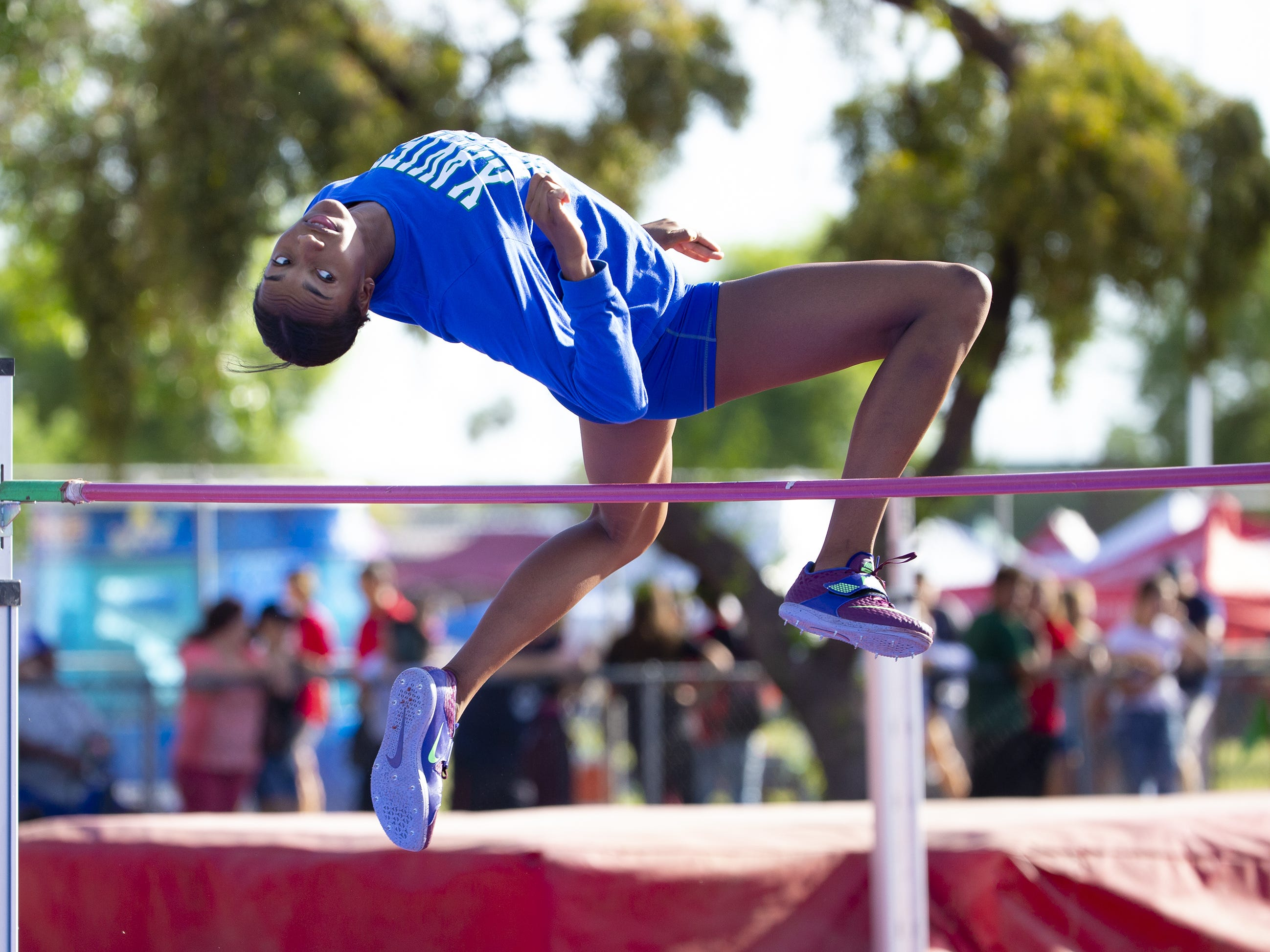 Xavier's Jada Sims warms up in the high jump during the state track and field meet at Mesa Community college on May 1, 2019.