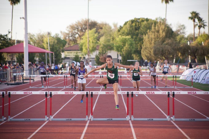 May 1, 2019; Campo Verde senior Kiana Kai wins a 300-meter hurdles heat at the 2019 girls state track and field championships at Mesa Community College.