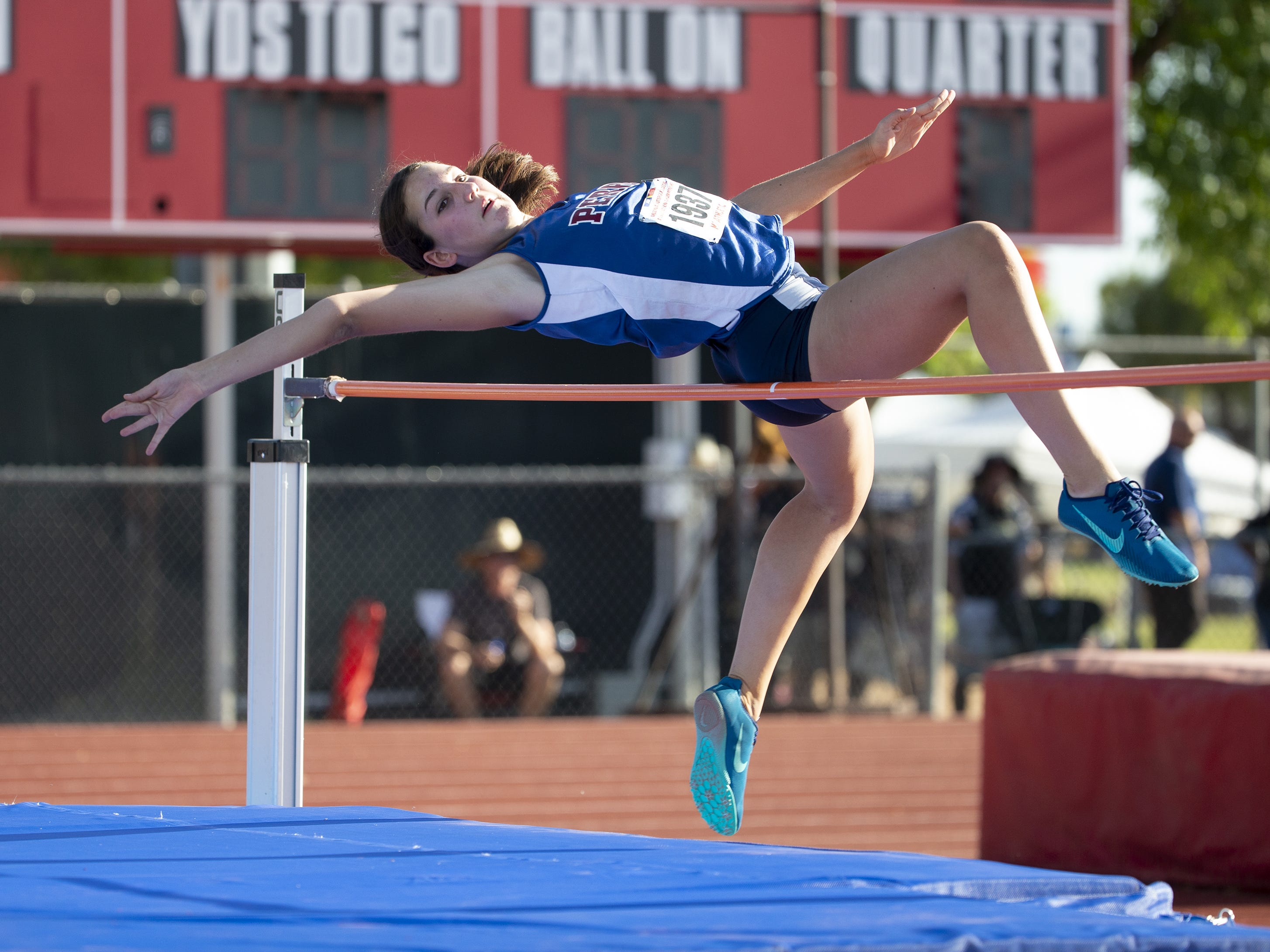 Perry's Emma Kozel competes in the high jump during the state track and field meet at Mesa Community college on May 1, 2019.