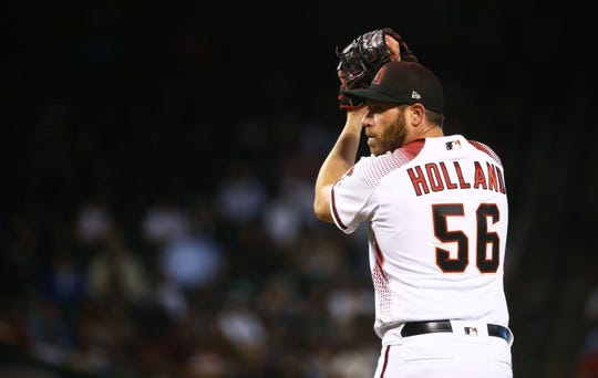 Diamondbacks pitcher Greg Holland throws to the New York Yankees in the ninth inning on May. 1, 2019 at Chase Field in Phoenix, Ariz.