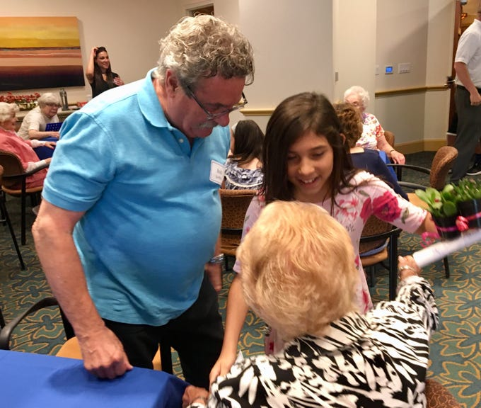 Brooklyn Perez, 11, greets her pen pals Sherlyn Scott and Bob Griffin at Vi at Grayhawk, a senior community in Scottsdale.
