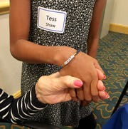 "Helen Hutchison, 93, a former music teacher, gave her pen pal Tess Shaw, 11, a bracelet with the word ""happy"" on it."