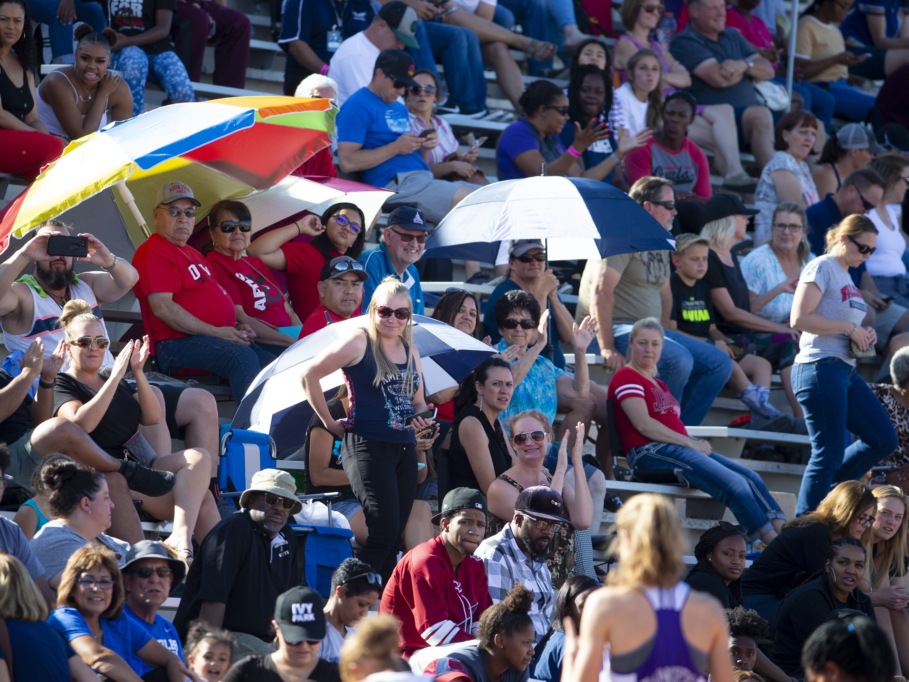 Fans cheer during the state track and field meet at Mesa Community college on May 1, 2019.