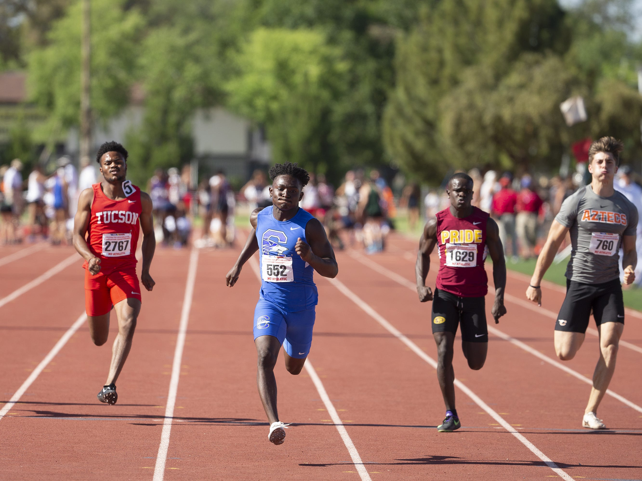 Division I Boys compete in the 100 Meter dash during the state track and field meet at Mesa Community college on May 1, 2019.