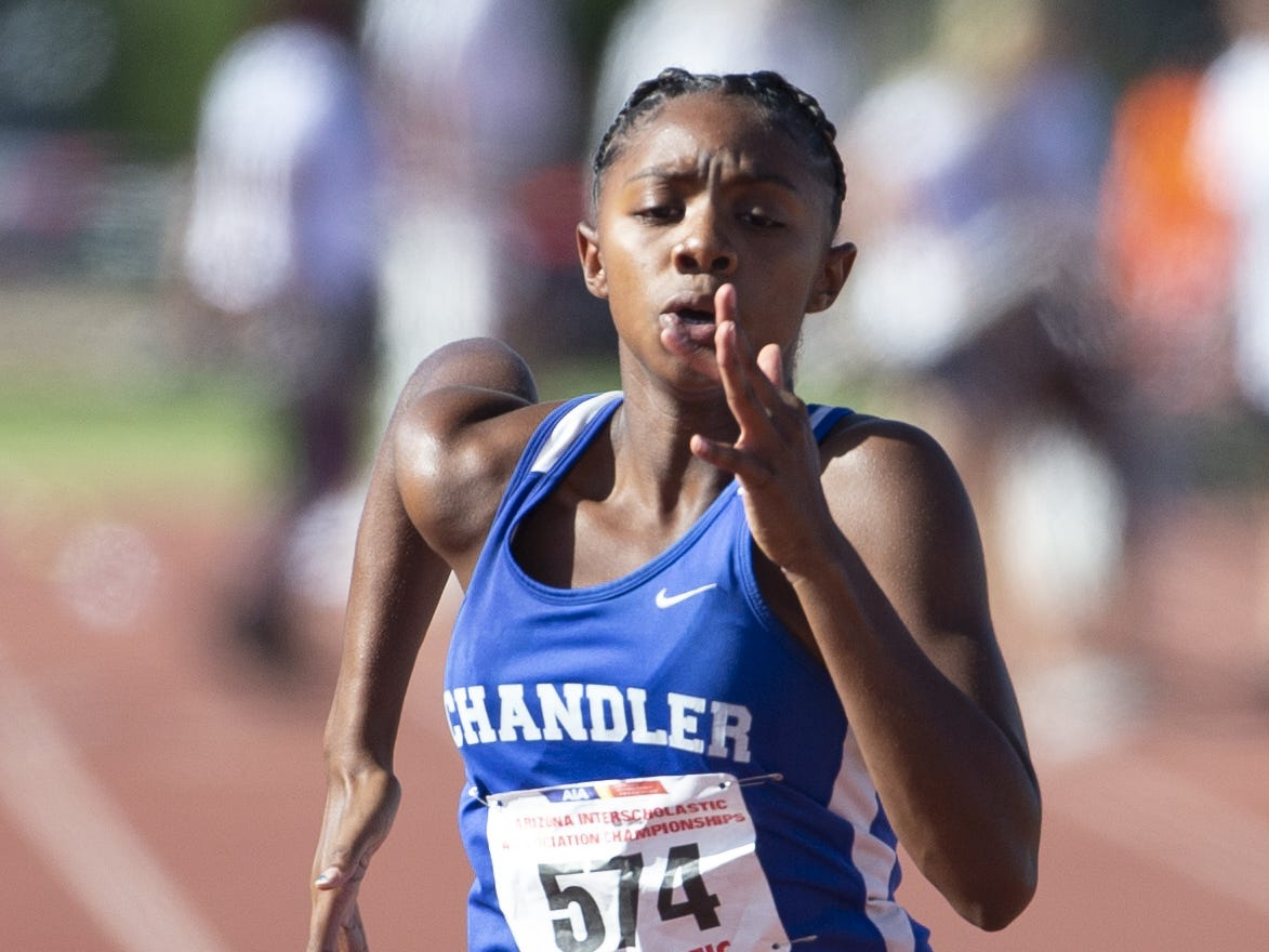 Chandler's Trinity Henderson competes in the Girls 100 meter dash Div. I during the state track and field meet at Mesa Community college on May 1, 2019.