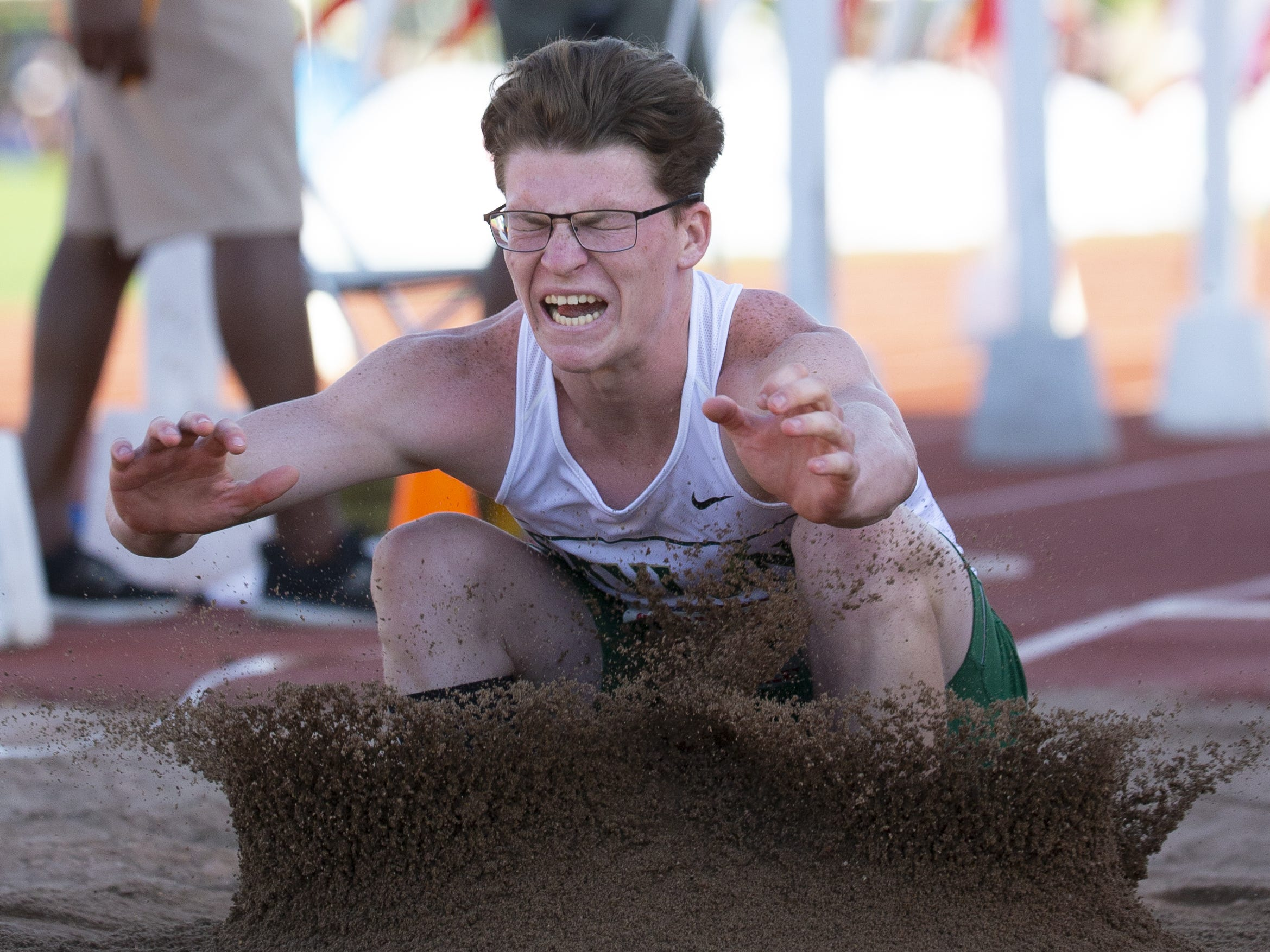 Skyline's Brendan Simpson competes in Boys long jump Div. I during the state track and field meet at Mesa Community college on May 1, 2019.
