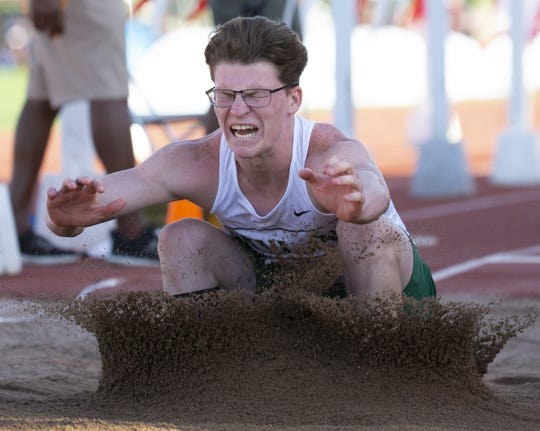Skyline's Brendan Simpson competes in Boys long jump Division I during the state track and field meet at Mesa Community college on May 1, 2019.