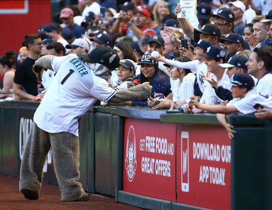 Diamondbacks mascot Baxter visits with some Yankees fans on April 30 at Chase Field, home of the Arizona Diamondbacks.