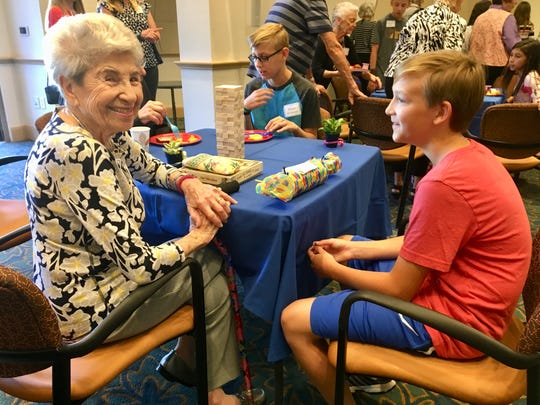 Ruth Katz, 94, showed her pen pal Dominic Williams, 11, a box of her tennis medals. Dominic, 11, recently played in his first tennis tournament and won a second-place medal.