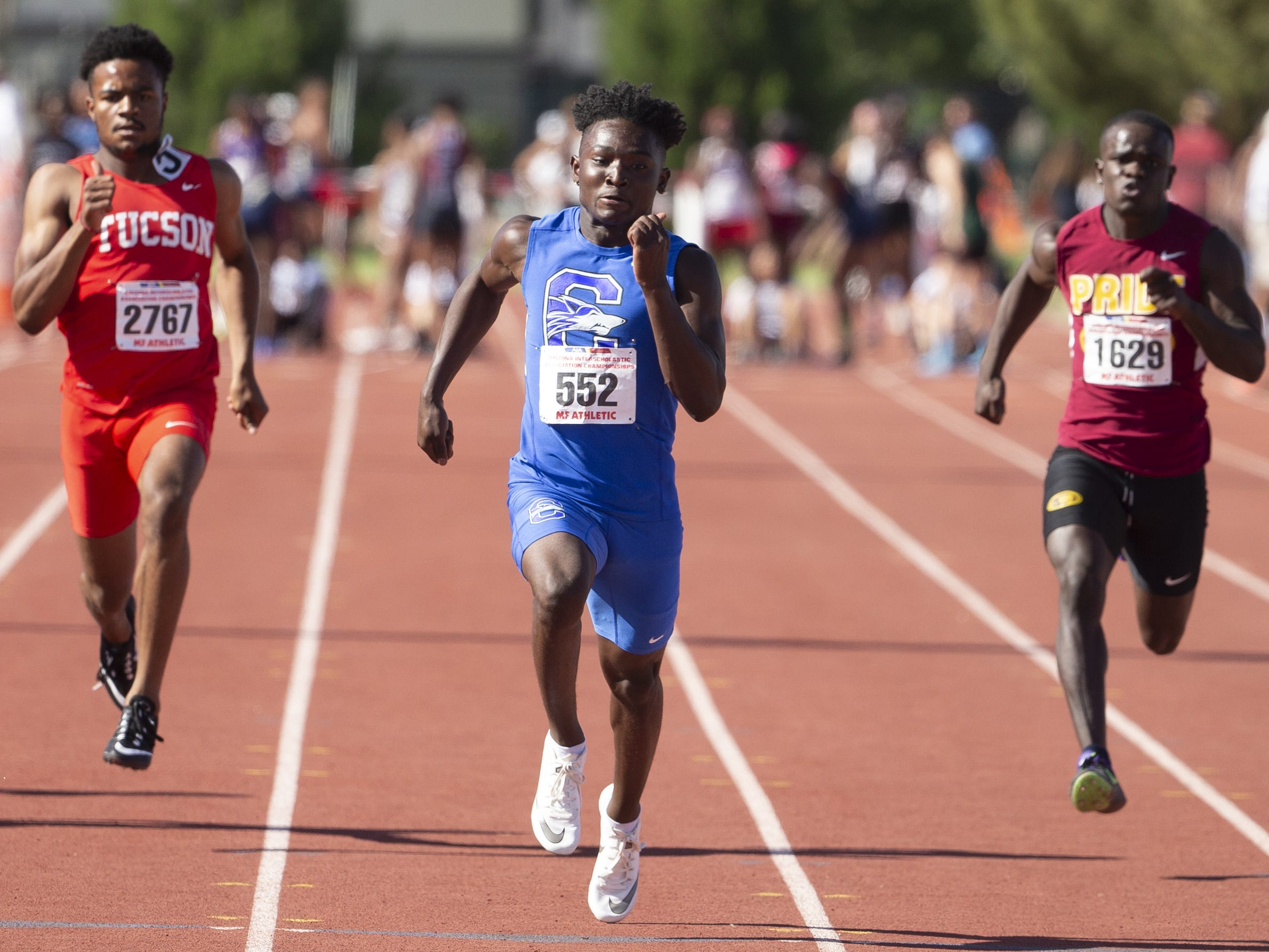 Mountain Pointe's Jathan Washington, Chandler's Quaron Adams, and Tucson's Octavius Thomas compete in the Boys 100 Meter dash Div. I during the state track and field meet at Mesa Community college on May 1, 2019.