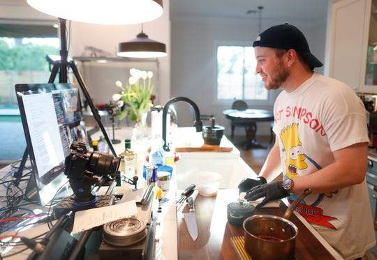 Chris Blackwood interacts with his audience during a live stream to Twitch making Chicken Piccata in his kitchen of his home in Phoenix, Ariz. on April 29, 2019.