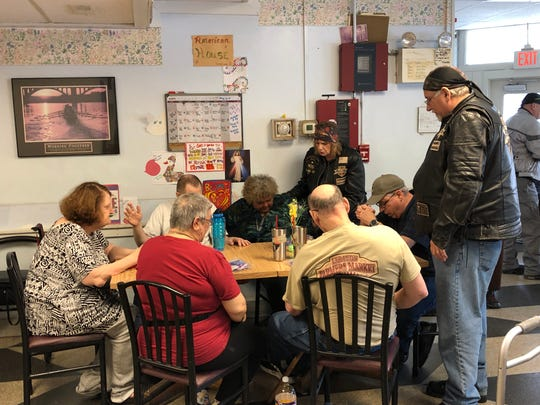 Members of the Christian Motorcyclists Association pray with residents of Lebanon's American House, a personal care facility.