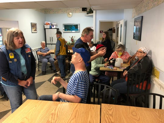 Members of the Christian Motorcyclists Association converse with residents of Lebanon's American House, a personal care facility.