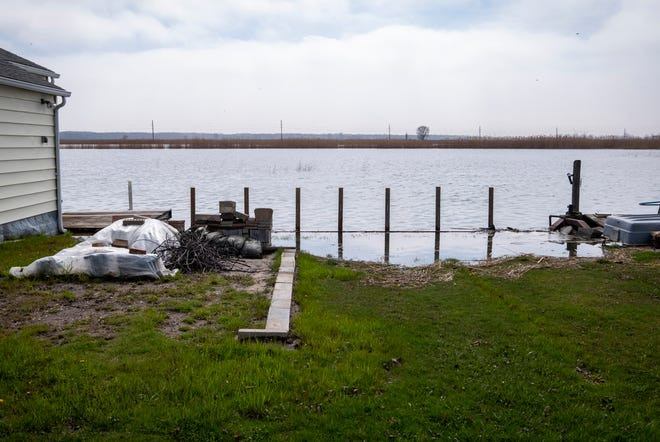 River water spills into a yard on Anchor Bay Drive Thursday, May 2, 2019 in Clay Township. Rain and snow runoff is leading to higher water levels, and officials aren't expecting it to stop.