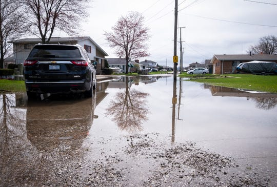 Water floods over a street in Clay Township Thursday, May 2, 2019. Rain and snow runoff is leading to higher water levels, and officials aren't expecting it to stop.