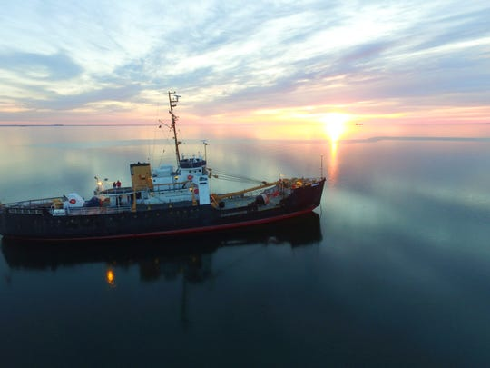 The Bramble cruises through Lake Erie at sunset.