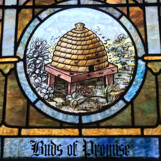 A stained-glass window depicting a beehive, one of the symbols of the City of Poughkeepsie, is featured at Smith Metropolitan AME Zion Church in Poughkeepsie.