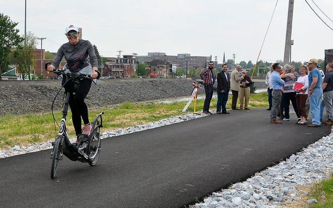 Patti Stirk of York rides her Eliptico bike on the new section of the Heritage Rail Trail following a ribbon cutting celebrating the completion of phase four construction, Thursday, May 2, 2019. John A. Pavoncello photo