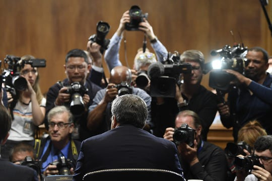 Attorney General William Barr is photographed as he sits down to testify before the Senate Judiciary Committee on Capitol Hill in Washington, Wednesday, May 1, 2019.  (AP Photo/Susan Walsh)