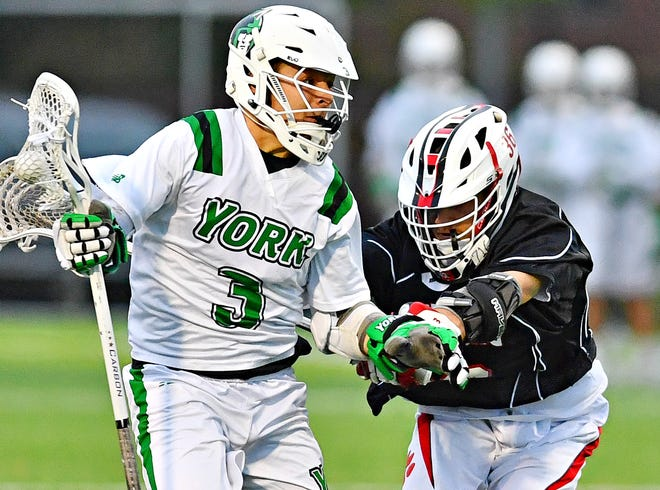 York College's Brad Casale, left, works to get past Frostburg's Jake Bowman during the Capital Athletic Conference semifinal game at York College in Spring Garden Township, Wednesday, May 1, 2019. Dawn J. Sagert photo