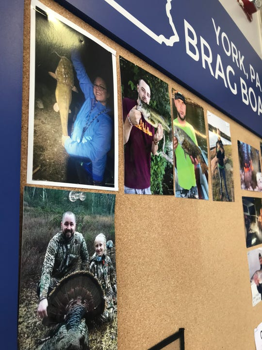 "A picture of 9-year-old Grace Shepheard and her dad, Kevin, is pinned on the ""brag board"" at Gander Outdoors in York."
