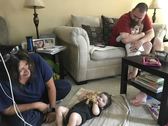 Jackson Kuhn was born without an anus and has spent much of his young life in hospitals. He is home now, cared for by his parents and visiting nurse Jenny Pierce.