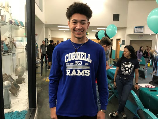 Kyle Claiborne will play football at Cornell College in Iowa. North Valleys had 15 students sign for college athletics on Thursday.