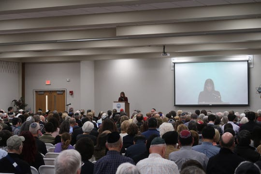 Keynote speaker Nurit Fischer-Shemer addresses hundreds Thursday at the Jewish Community Center during a Holocaust remembrance ceremony.