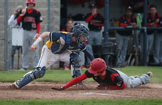 Penfield's Nathan Sobko is tagged out by Victor catcher Sam DiGiacomo as he tries to steal home in the fourth inning during their matchup Wednesday, May 1, 2019 at Victor.