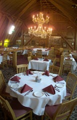 Feb. 20, 2001: A chandelier lights up the main dining hall at the Crystal Barn restaurant in Pittsford.
