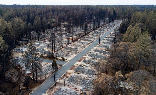 FILE- In this Dec. 3, 2018, file photo, homes leveled by the Camp Fire line the Ridgewood Mobile Home Park retirement community in Paradise, Calif. California officials Wednesday, May 1, 2019, announced the state's annual population estimates. The last estimate put the state on the cusp of 40 million residents. The devastating wildfires in 2018 destroyed more than 14,600 housing units, including 90% of the housing stock in Paradise. (AP Photo/Noah Berger)