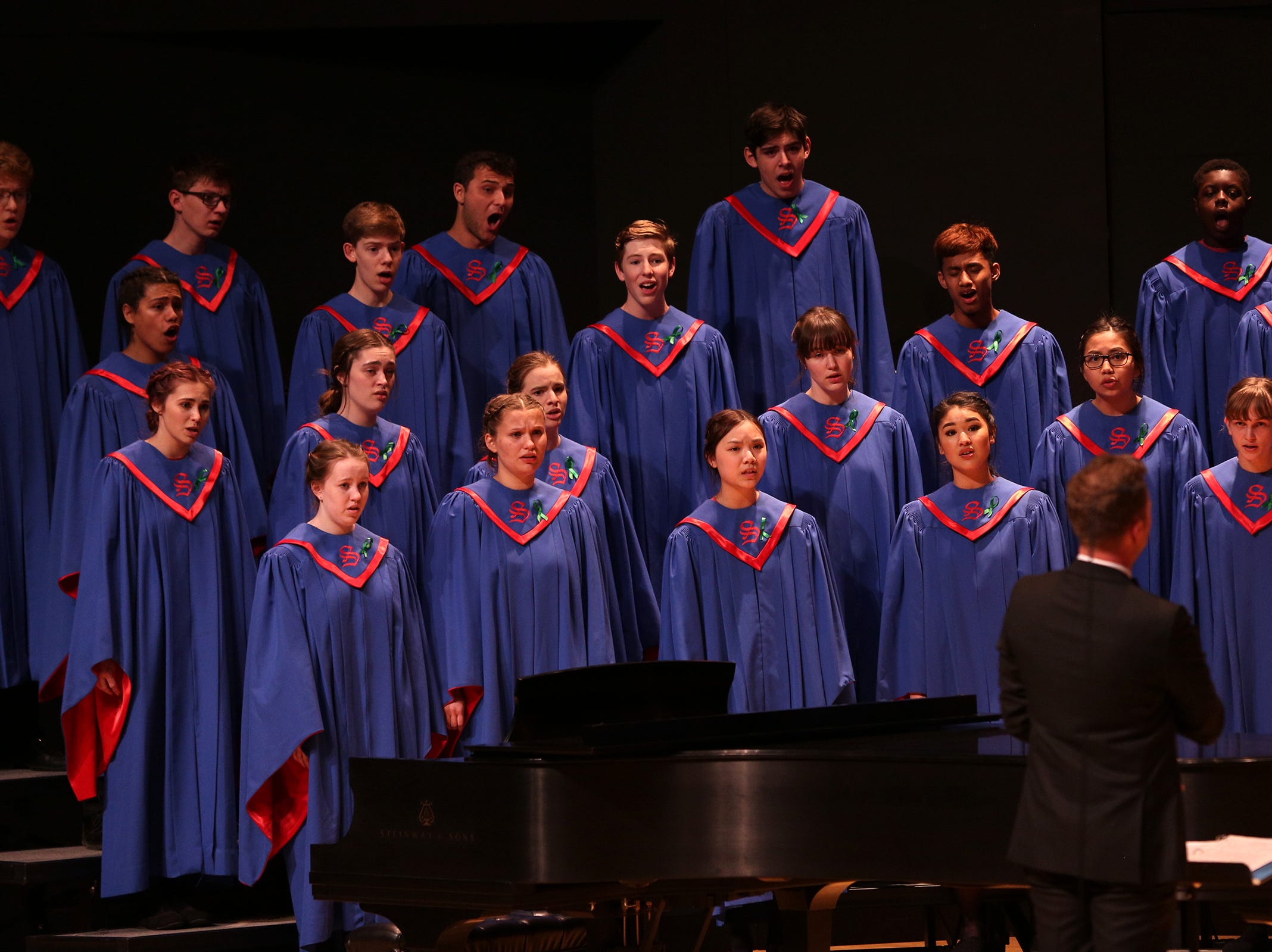 South Salem's choir, under the direction of William McLean, performs at the OSAA Choir State Championships at Oregon State University in Corvallis on May 1, 2019.