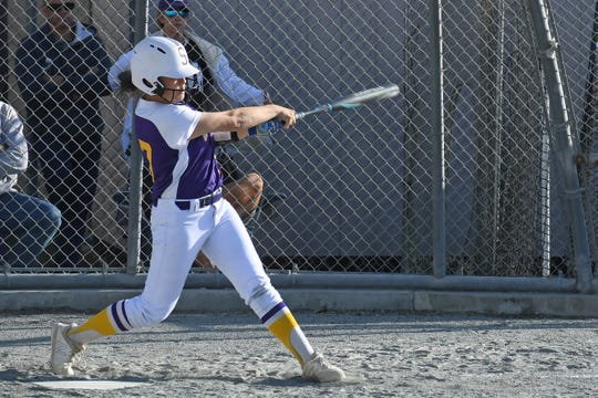 Salinas shortstop Kayla Stone (27) knocks a grounder down the left side of the infield.