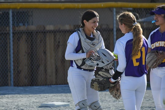 "Piñon (left) stepped her game up as a junior for the Cowboys when they moved to the Gabilan division. ""Defensively, her junior year she became the focal point and support among the pitching staff,"" former Cowboys coach Lauren Jimenez said."