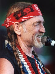 Willie Nelson performing at a concert to benefit liver transplant patient Barbara Edwards and Ted Westover near Sherwood in June of 1987.