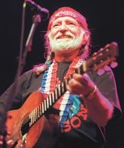 Willie Nelson gives a big smile to his San Angelo fans at the Bill Aylor Sr. Riverstage in 1997.