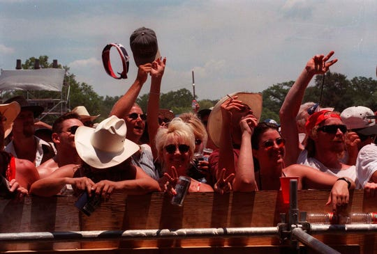Folks celebrate during Willie Nelson's 4th of July Picnic in 1999.