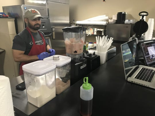 Personal trainer Art Rahman making a smoothie at Art's Bistro in Community Health Club, 3336 W. Loop 306 Thursday, May 2, 2019.