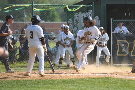 Mardela's Jaden Shelton scores a run against Decatur on Wedesnday, May 1, 2019.
