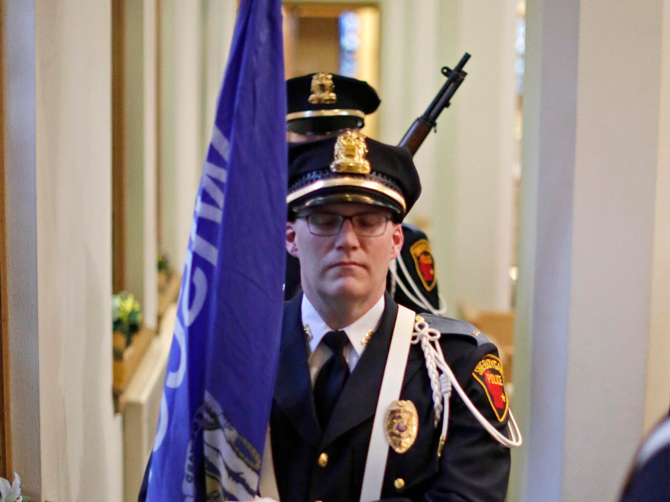 Lt. Kurt Zempel of the Sheboygan Police Department Color Guards carries a flag at the start of the National Day of Prayer, Thursday, May 2, 2019, at Fountain Park Church, in Sheboygan, Wis.